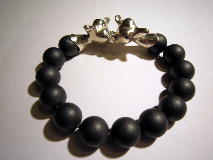 Silver bracelet with hematite beads.