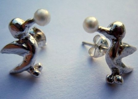 Earrings with silver birds pecking little